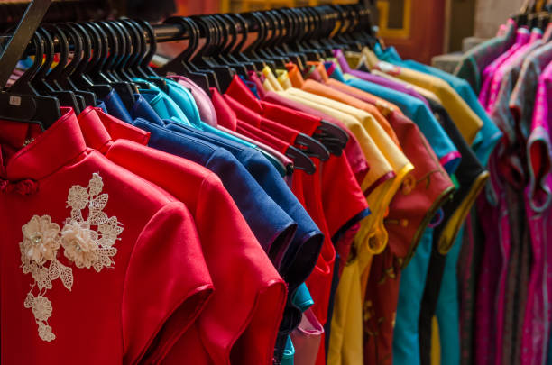 Colorful chinese cheongsam hanging for sale during Chinese New Year. stock photo