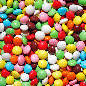 Lots of colorful chocolate candies. Can be used as a background.