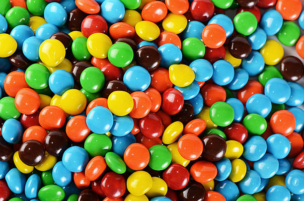 Colorful chocolate candies Closeup of pile of colorful chocolate candies candy stock pictures, royalty-free photos & images