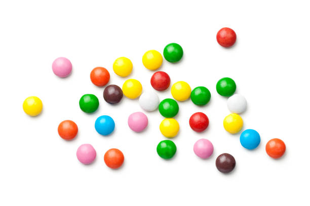 colorful chocolate candy pills isolated on white background - candy stock pictures, royalty-free photos & images
