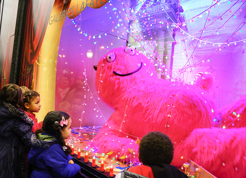 Colorful Christmas decoration in the windows of Galeries Lafayette.