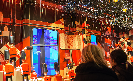 Colorful Christmas decoration in the windows of Printemps department store.