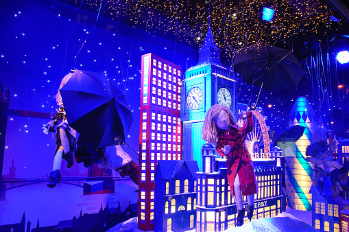 Colorful Christmas decoration in windows of Printemps department store.