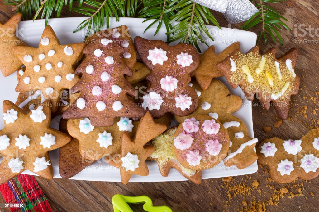 Colorful Christmas gingerbread cookies on wooden background royalty-free stock photo