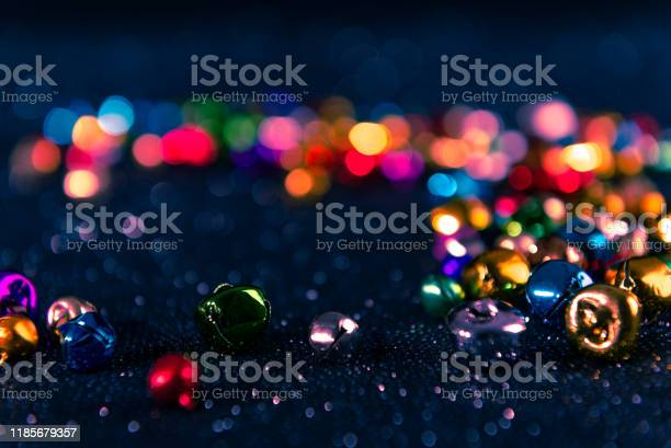 Colorful Christmas Jingle Bells Blue Filter Blurred Bokeh Background Stock Photo - Download Image Now