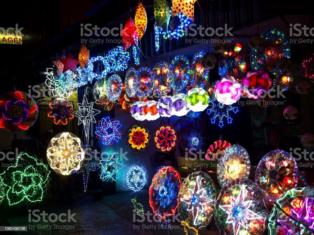 Colorful Christmas lanterns on display at a store stock photo