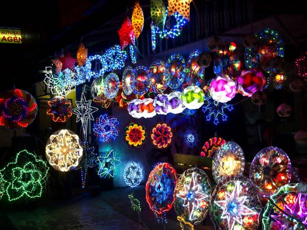 colorful christmas lanterns on display at a store - philippines stock photos and pictures