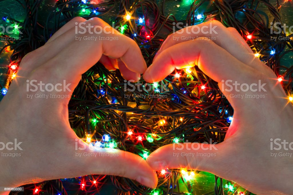 Christmas Lighted Garlands.Colorful Christmas Lights Garlands Inside The Heart Stock