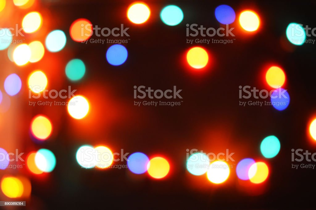 Colorful Christmas lights glowing in the night, abstract background stock photo