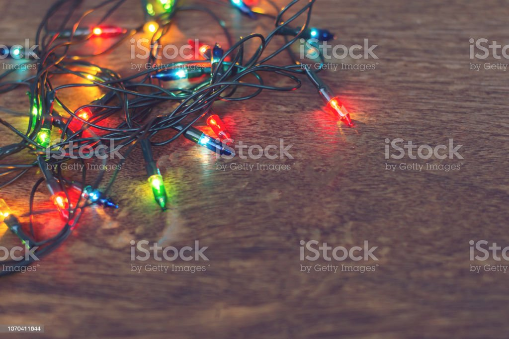 Colorful Christmas Lights Background.Colorful Christmas Lights Over Dark Wooden Background Flat Lay With Copy Space Stock Photo Download Image Now