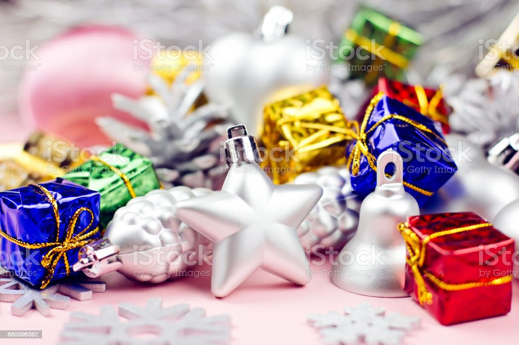 Colorful Christmas ornaments close up on a pastel background stock photo