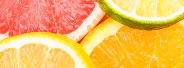 Colorful Citrus fresh fruits including grapefruit, lime, lemon and orange cross section studio shot - foto stock