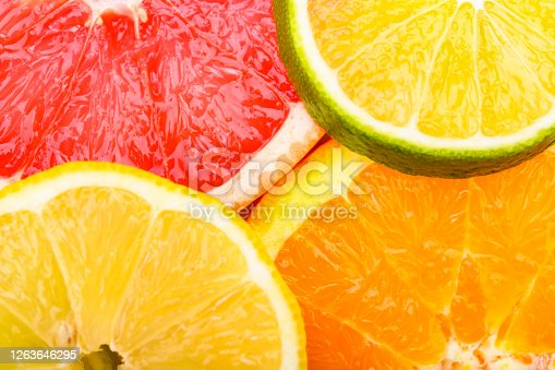 Colorful Citrus fresh fruits including grapefruit, lime, lemon and orange cross section studio shot
