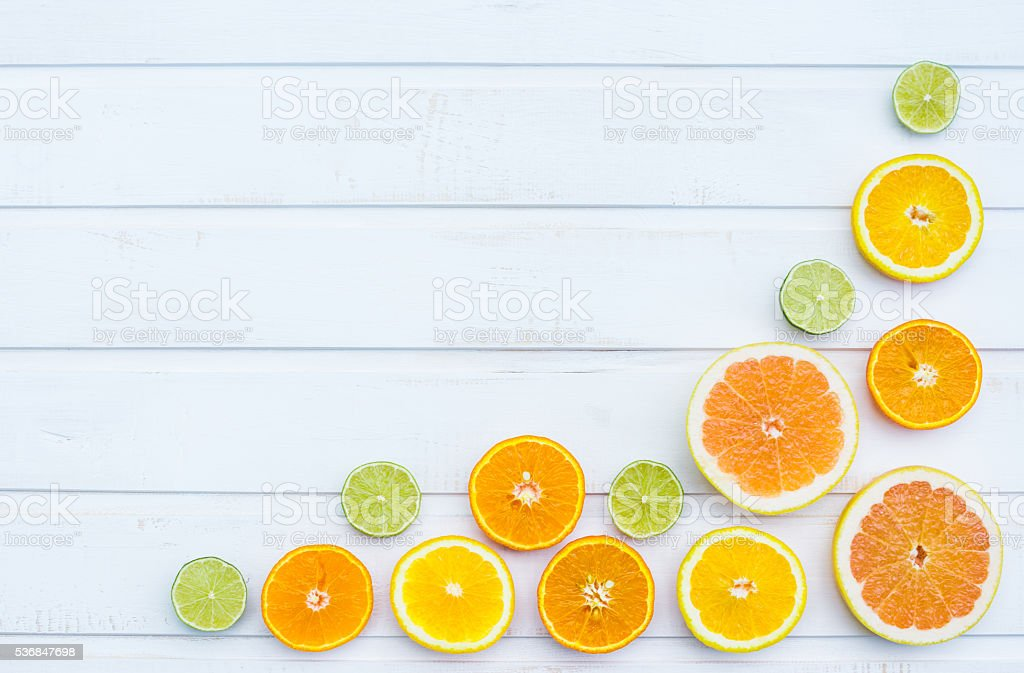 Colorful citrus fruits on the rustic white background stock photo