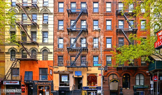 22.05.2016. Colorful classic old buildings, architecture and facade with windows, balcony and small shops in east village Manhattan, New York City