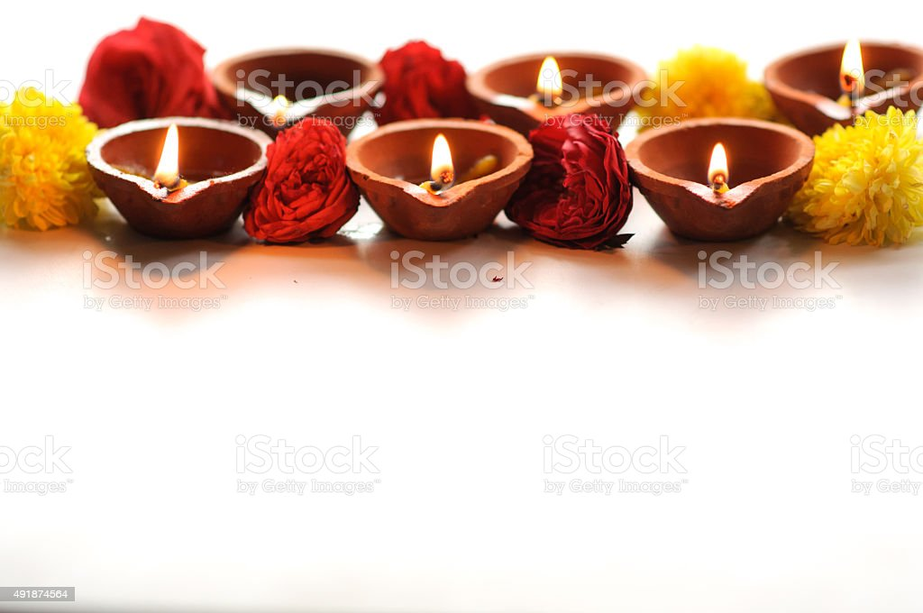 Colorful clay diya lamps lit during diwali celebration stock photo