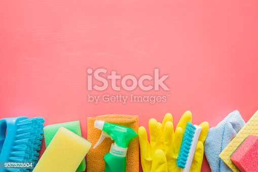 918825114 istock photo Colorful cleaning set for different surfaces in kitchen, bathroom and other rooms. Empty place for text or logo on pink background. Cleaning service concept. Early spring regular clean up. Top view. 932323504
