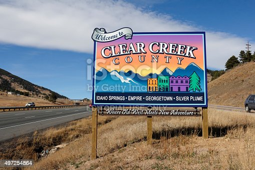 Genesee, CO, USA - November 8, 2014: Westbound on I-70 towards Idaho Springs, Empire, Georgetown, SilverPlume and more towns, Where Old West Meets New Adventure, sign.