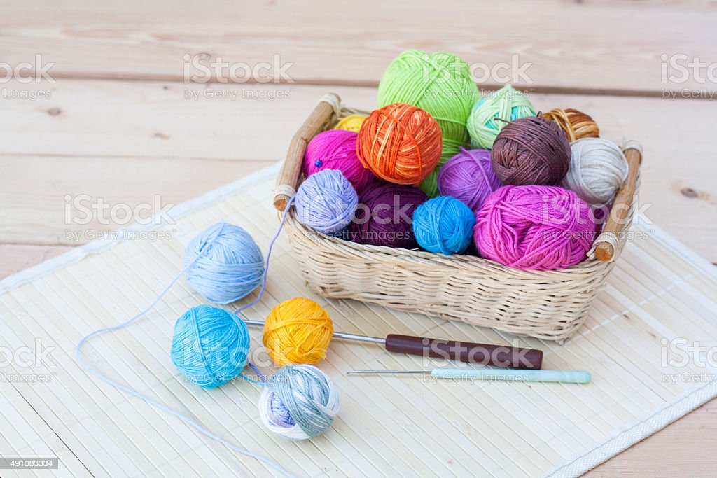 Colorful clews and crochet hook royalty-free stock photo