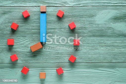 istock Colorful clock from wooden cubes, eight hour. 1065346760