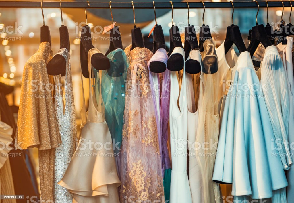 Colorful clorhes on racks in a fashion boutique stock photo