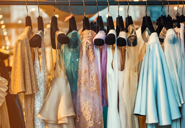 Colorful clorhes on racks in a fashion boutique Colorful clorhes on racks in a fashion boutique dress stock pictures, royalty-free photos & images