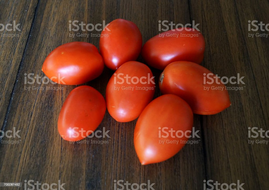 Colorful close up photo of oval roma tomatoes stock photo