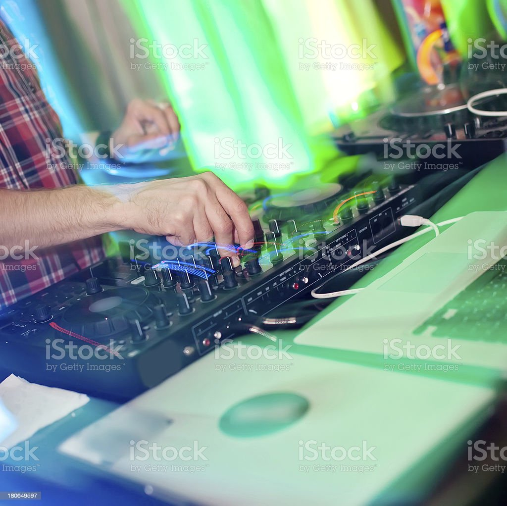 Colorful close-up of DJ mixing royalty-free stock photo