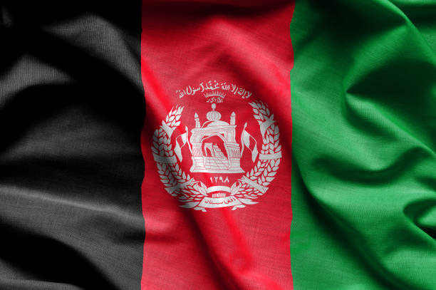 Colorful, closeup, wavy flag of Afghanistan Colorful, closeup, wavy fabric flag of Afghanistan fills the frame Afghanistan stock pictures, royalty-free photos & images