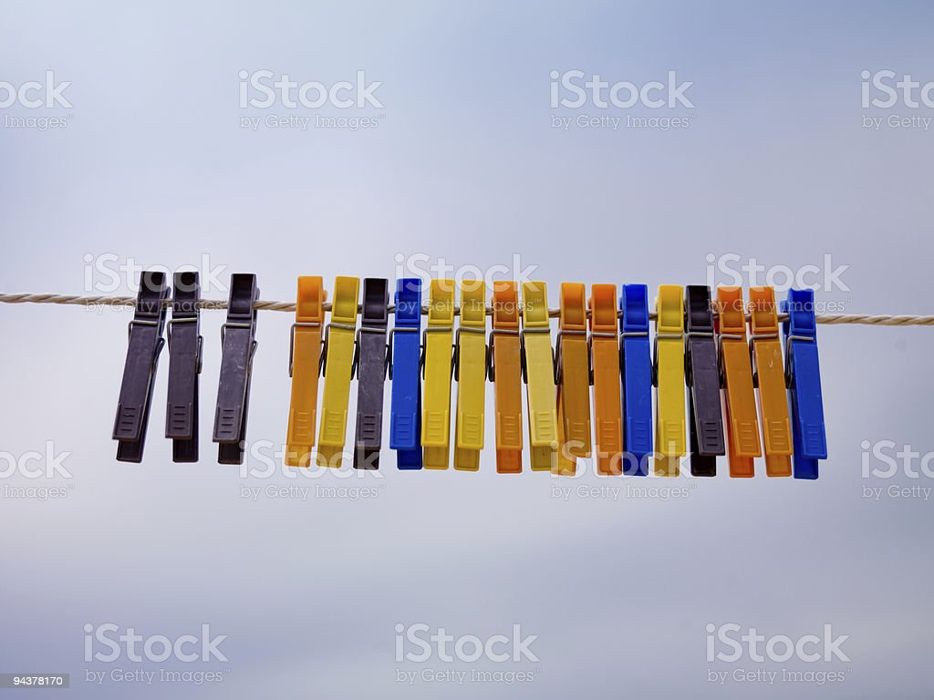 Colorful clothepins on the line stock photo