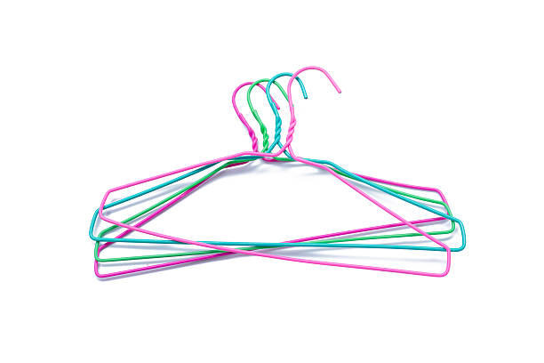 colorful clothes hanger isolated on white - drahtkleiderbügel stock-fotos und bilder