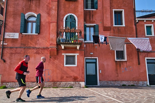 Colorful clothes hanging in front of a building in Venice, Italy