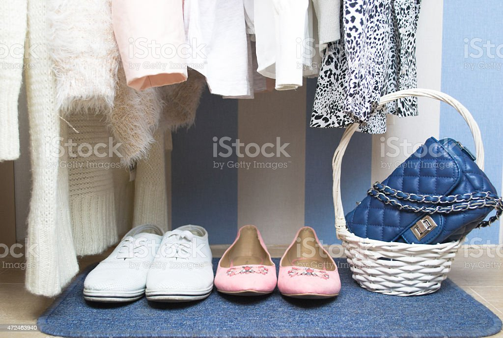 Colorful clothes hanging in wardrobe stock photo
