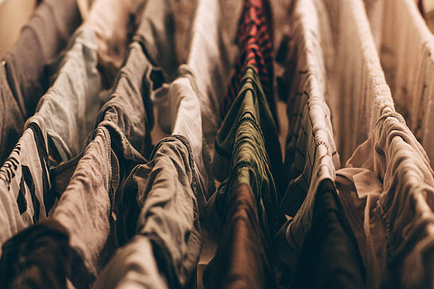 colorful clothes hung out dries in the dryer - horizontal gestreiften vorhängen stock-fotos und bilder