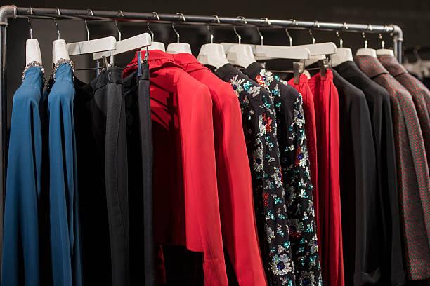 colorful clothes in a fashion store in milan - papierrollenhalter stock-fotos und bilder