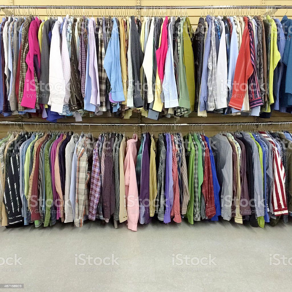 Colorful clothes in a second hand store stock photo