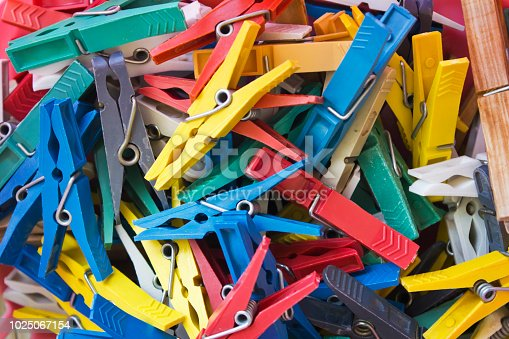 Background of colorful clothes pegs