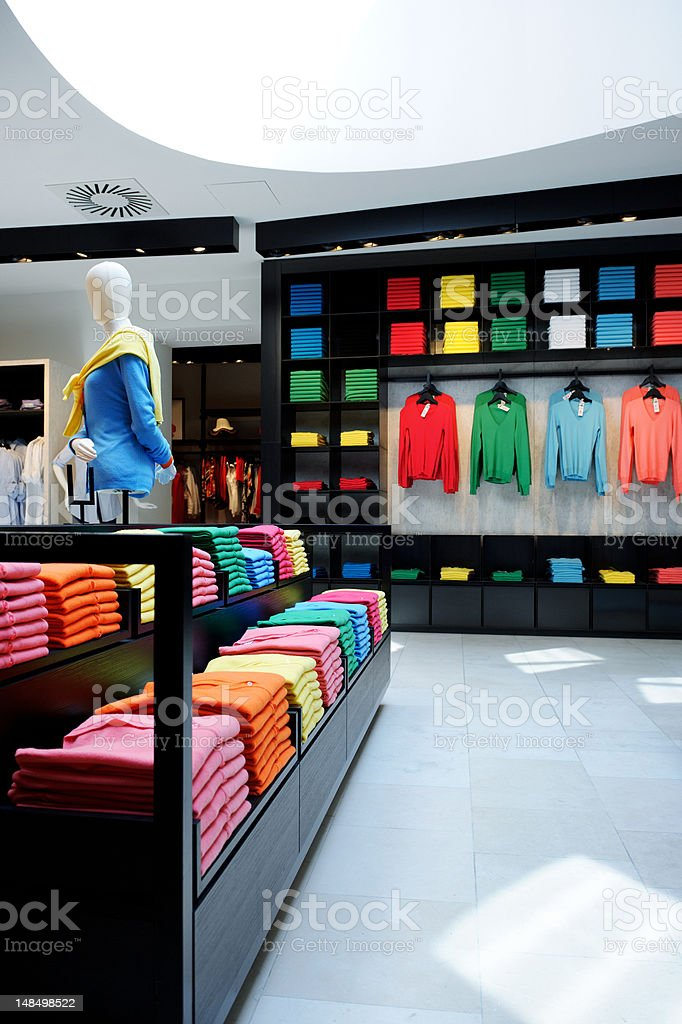 Colorful clothes shop interior royalty-free stock photo