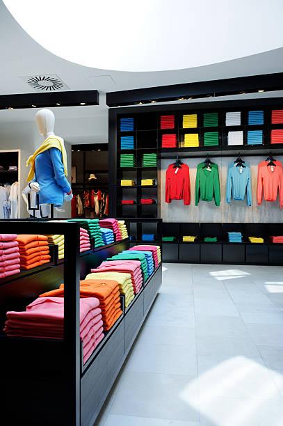 Colorful clothes shop interior stock photo