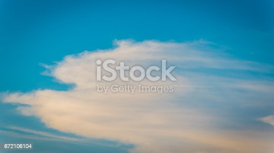 529114076 istock photo Colorful clouds against clear sky 672106104
