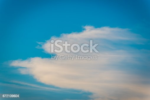 529114076 istock photo Colorful clouds against clear sky 672109604
