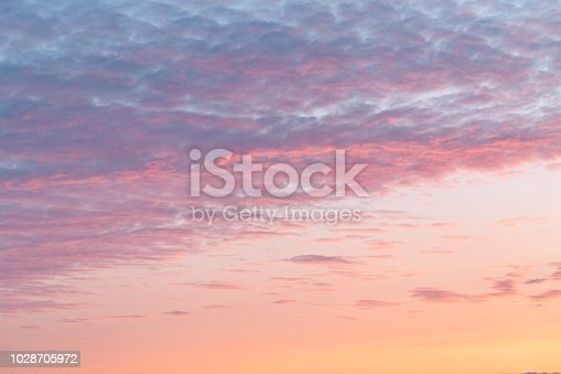 Colorful clouds on dramatic sunset sky. This file is cleaned and retouched.