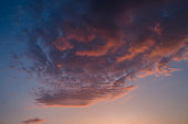 Colorful clouds on dramatic sunset sky