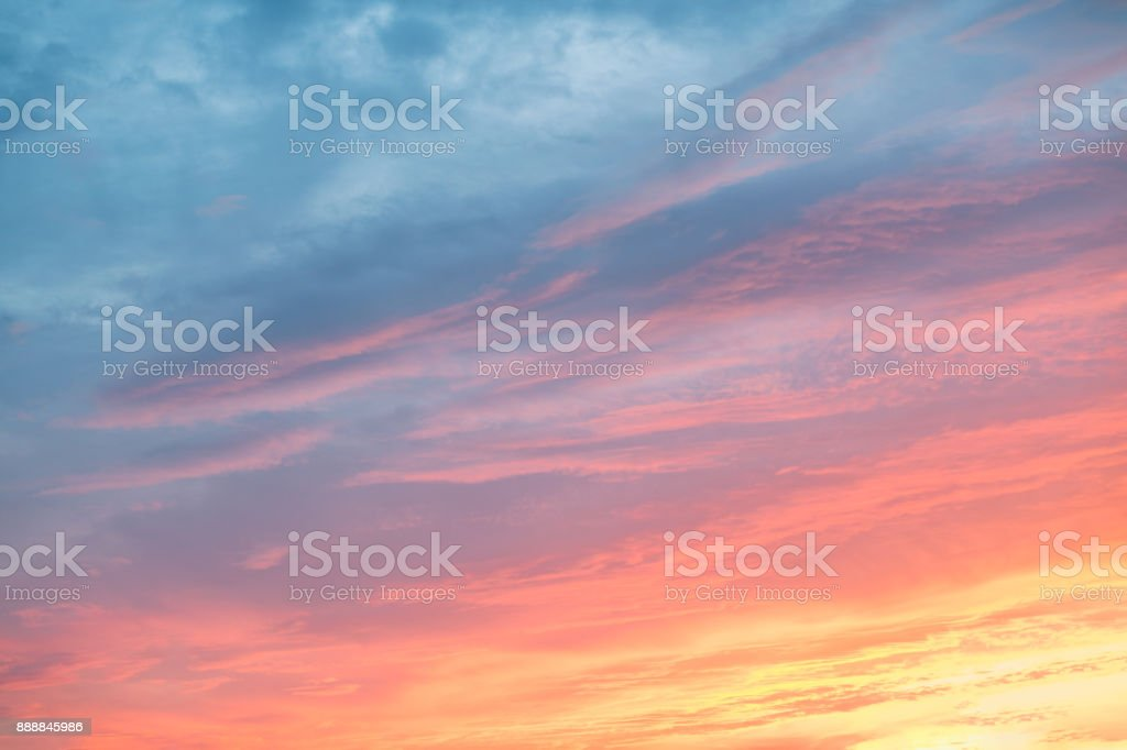 Colorful clouds on dramatic sunset sky stock photo