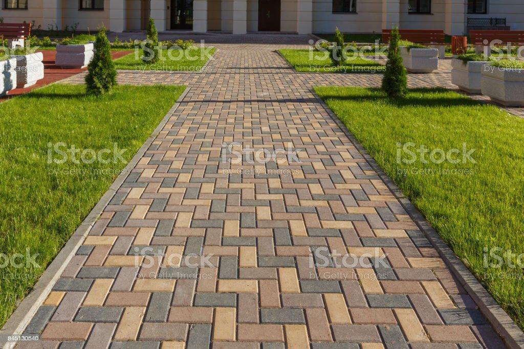 Colorful cobblestone road pavement stock photo