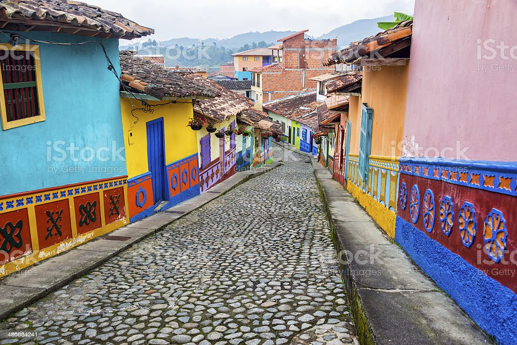 Colorful Cobblestone Street Colorful colonial houses on a cobblestone street in Guatape, Antioquia in Colombia Antioquia Stock Photo
