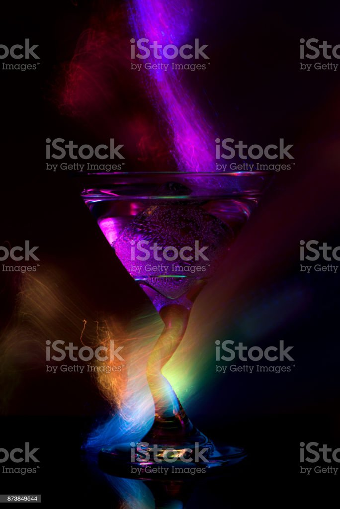 colorful cocktail in glass in neon light stock photo