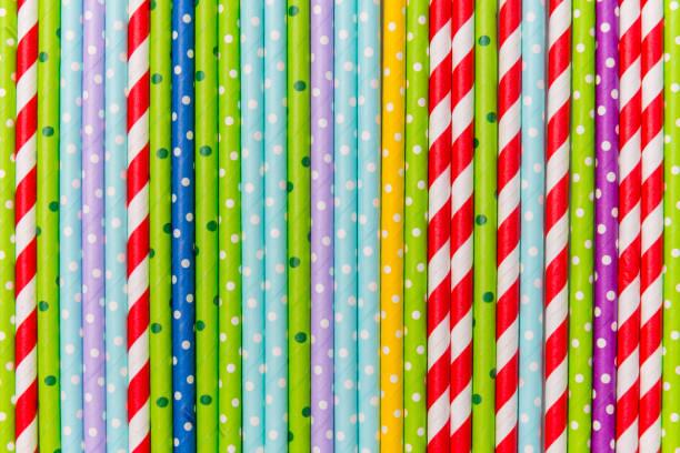 colorful cocktail tubes lie closeup. Top view image. stock photo