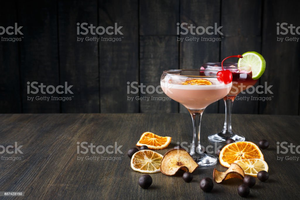 Colorful cocktails over rustic wood background stock photo