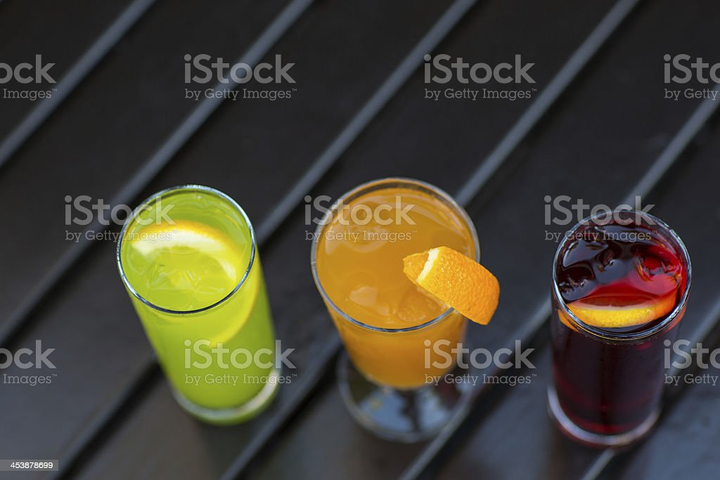 Colorful cocktails with straw on wood table royalty-free stock photo